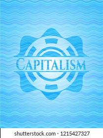 Capitalism light blue water badge.