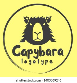 Capybara Vector Logo design template. silhouette of animal logotype with Negative space style. Badge of a gentle mammal for cafe, shop, vegan products.