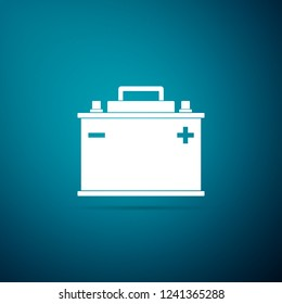 Car battery icon isolated on blue background. Accumulator battery energy power and electricity accumulator battery. Flat design. Vector Illustration