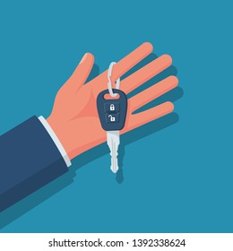 Car key hold in hand. Vector illustration flat design. Isolated on background. Maybe as a template for the sale, purchase, rental, presentation. Give or show keys.