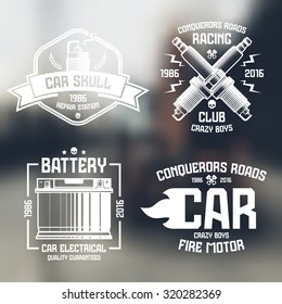 Car repair and racing emblems. Graphic design elements for t-shirt. White print on blurred background