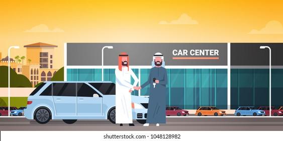 Car Showroom Background, Purchase Sale Or Rental Center Arab Seller Man Giving Keys To Owner