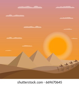 Caravan of camels near Egypt pyramids. Egypt sunset. Egypt pyramids.Caravan of camels. Egypt sands with pyramids.