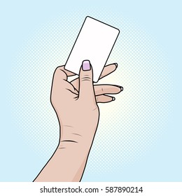 card or bank card in a female hand pop art retro style. Fingers holding a white rectangle. Advertising blank business