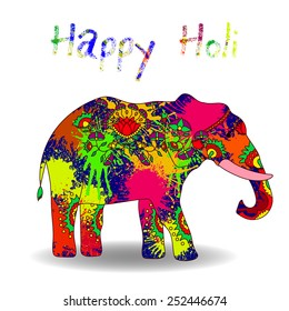 Card with colorful elephant and splatter. Holi festival of colors.