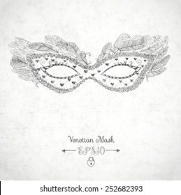 Card with festive venetian mask decorated with feathers on white textured background