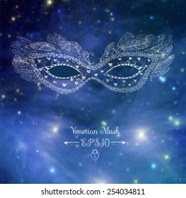 Card with festive venetian mask. Elements of this image furnished by NASA.