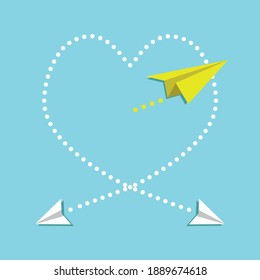 Cardboard airplanes creating heart symbol in the air. The plane passing through the heart, the cardboard plane. The plane coming out of the cabin.