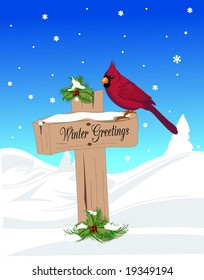Cardinal resting on holiday sign