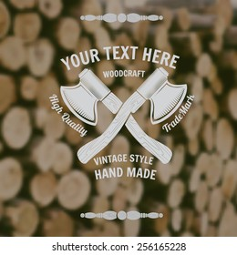 carpenter craft style background with cross axes middle on old stack of wood blur photo