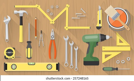 Carpentry and home renovation tools on a wooden table top view