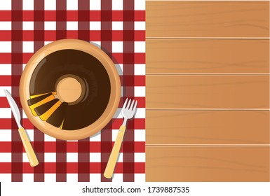 carrot cake with chocolate - festa junina food, on checkered tablecloth and wooden table top view