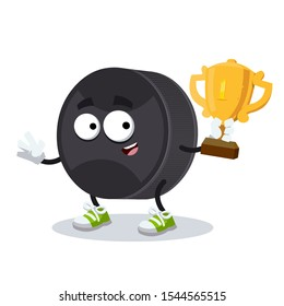 cartoon black rubber hockey puck mascot holds the number one cup on white background