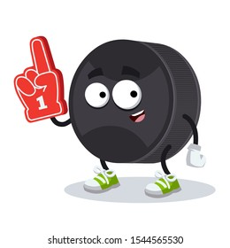 cartoon black rubber hockey puck character mascot with the number 1 one sports fan hand glove on a white background