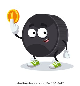 cartoon black rubber hockey puck mascot keeps the coin on white background
