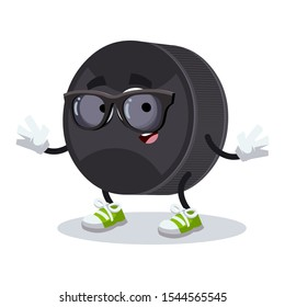 cartoon black rubber hockey puck character mascot in black sunglasses on a white background