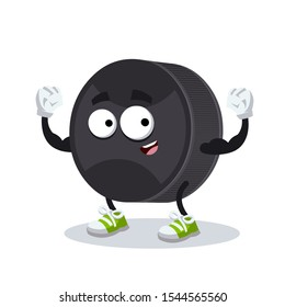 cartoon black rubber hockey puck mascot shows its strength on a white background