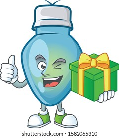 cartoon character of happy blue christmas bulb with gift box