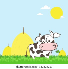 Cartoon cow on a green field with stacked hay in the background