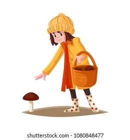 Cartoon girl kid in autumn outdoor clothing collecting mushrooms into wicker basket. Female kid in orange coat, hat. rubber boots, reaching out hand to pick mushroom. Vector illustration