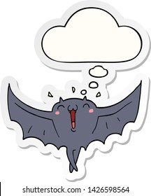 cartoon happy vampire bat with thought bubble as a printed sticker