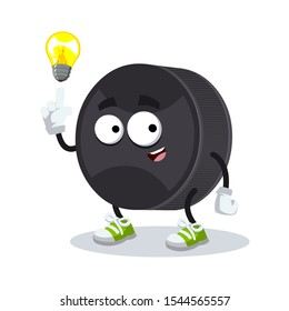 cartoon have an idea black rubber hockey puck mascot on white background