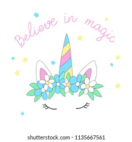 Cartoon head of the unicorn with flower wreath and inscription Believe in magic. Vector illustration.