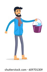 Cartoon man with bucket full of water isolated on white. Young smiling male person with black hair and wearing blue jacket, grey trousers, beige shoes and light brown scarf holds pail. Vector
