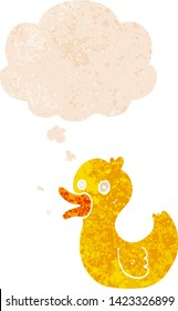 cartoon quacking duck with thought bubble in grunge distressed retro textured style