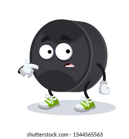 cartoon scared black rubber hockey puck mascot in sneakers on a white background
