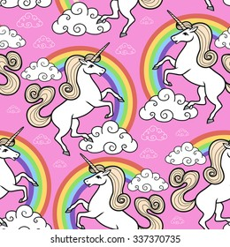 Cartoon seamless pattern. Unicorn with rainbow and clouds. For designed print.