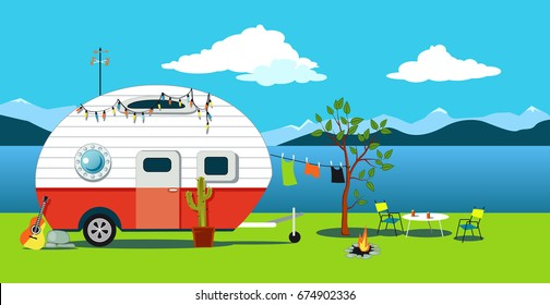 Cartoon traveling scene with a vintage camper, a fire pit, camping table and laundry line, EPS 8 vector illustration, no transparencies