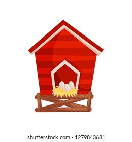 Cartoon vector icon of bright red chicken coop, fresh eggs in the nest. Wooden house for domestic birds