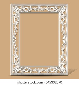 carved vintage frame made of paper for picture or photo with shadow on light background