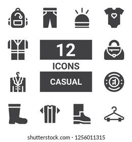 casual icon set. Collection of 12 filled casual icons included Hanger, Boots, Tshirt, Chelsea, Jacket, Handbag, Trousers, Baby clothes, Backpack, Hooter