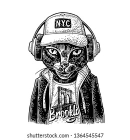 Cat to headphones dressed in the hoodie, baseball cap, t-shirt with the Brooklyn Bridge. Vintage black engraving illustration. Isolated on white background. Hand drawn design element for poster