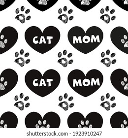 Cat mom and cute black hearts and doodle paws. Happy Mother's Day background, fabric design seamless pattern.