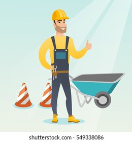 Caucasian builder with thumb up standing near wheelbarrow and traffic cones. Builder in hard hat giving thumb up. Builder at work on construction site. Vector flat design illustration. Square layout.