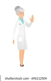 Caucasian doctor in medical gown showing stop hand gesture. Senior doctor doing stop gesture. Serious doctor with a stop gesture. Vector flat design illustration isolated on white background.