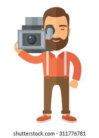 A caucasian videographer with his video camcorder. A Contemporary style. Vector flat design illustration isolated white background. Vertical layout