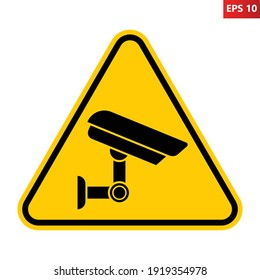 Caution CCTV camera in operation sign. Vector illustration of yellow triangle warning sign with security video camera icon inside. Surveillance zone symbol isolated on background. Monitored area.