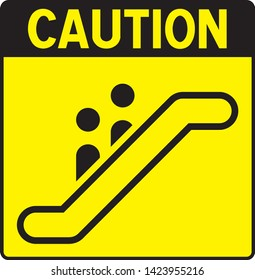 Caution: Escator sign with danger label and yellow background