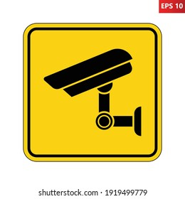 Caution surveillance camera in operation sign. Vector illustration of yellow square warning sign with security video camera icon inside. CCTV zone symbol isolated on background. Monitored area.