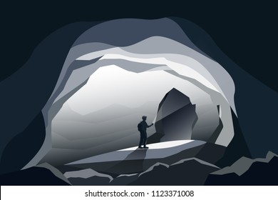 caves landscape and man standing at front cave entrance