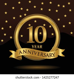 Celebrating 10 years anniversary with golden ring and ribbon and laurel branches on dark background, vector design.