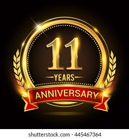 Celebrating 11 years anniversary logo with golden ring and red ribbon.