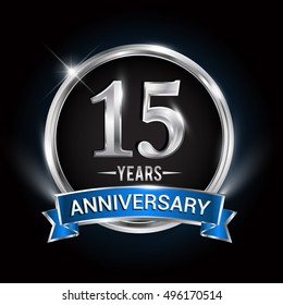 Celebrating 15 years anniversary logo with silver ring and blue ribbon.