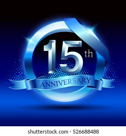 Celebrating 15 years anniversary logo. with silver ring and blue ribbon,