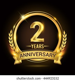 Celebrating 2 years anniversary logo with golden ring and ribbon, laurel wreath vector design.