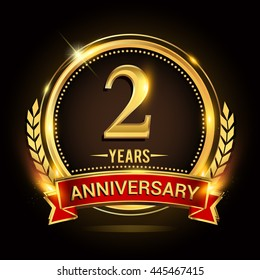 Celebrating 2 years anniversary logo with golden ring and red ribbon.